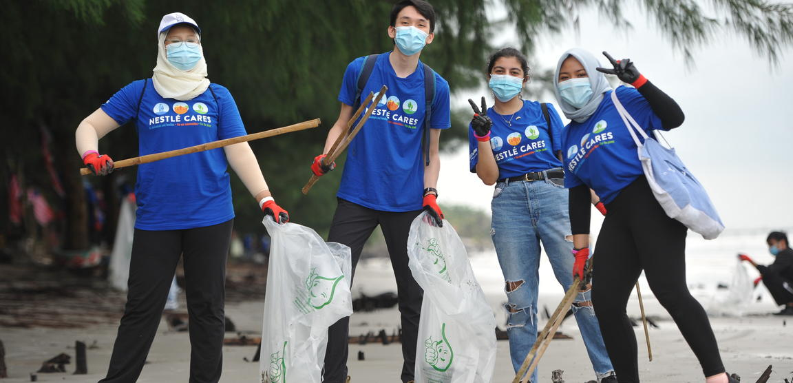A group of volunteers during a beach clean up.